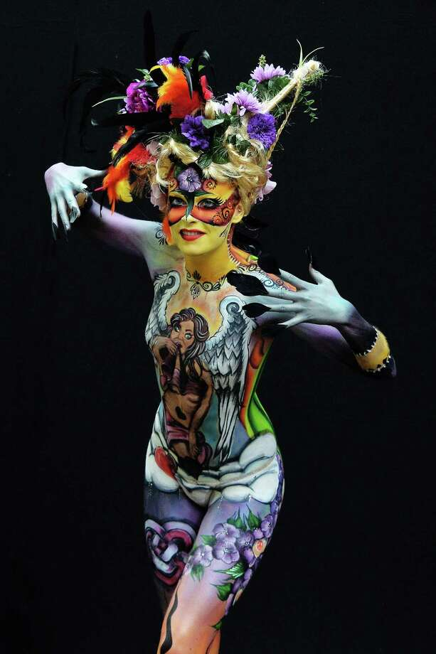 A participant poses with her body paintings designed by bodypainting artist Caroline Bartholomeus during the 16th World Bodypainting Festival on July 5, 2013 in Poertschach am Woerthersee, Austria. Photo: Didier Messens, Getty Images / 2013 Didier Messens