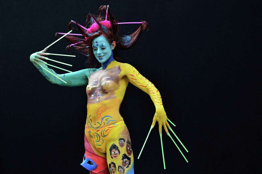 A participant poses with her body paintings designed by bodypainting artist Norbert Dahn during the 16th World Bodypainting Festival on July 5, 2013 in Poertschach am Woerthersee, Austria. Photo: Didier Messens, Getty Images / 2013 Didier Messens