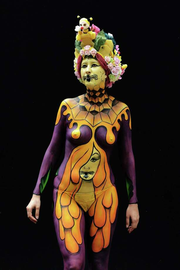 A participant poses with her body paintings designed by bodypainting artist Sandra Rijke during the 16th World Bodypainting Festival in Poertschach on July 6, 2013 in Poertschach am Woerthersee, Austria. Photo: Didier Messens, Getty Images / 2013 Didier Messens