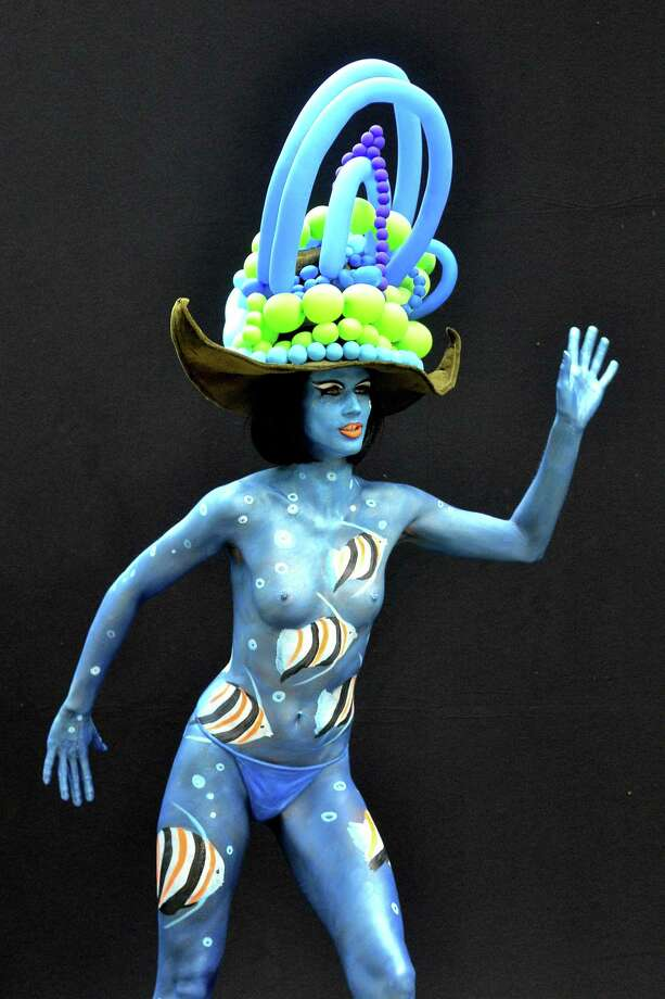 A participant poses with her body paintings designed by bodypainting artist Marlies Brinker during the 16th World Bodypainting Festival in Poertschach on July 6, 2013 in Poertschach am Woerthersee, Austria. Photo: Didier Messens, Getty Images / 2013 Didier Messens
