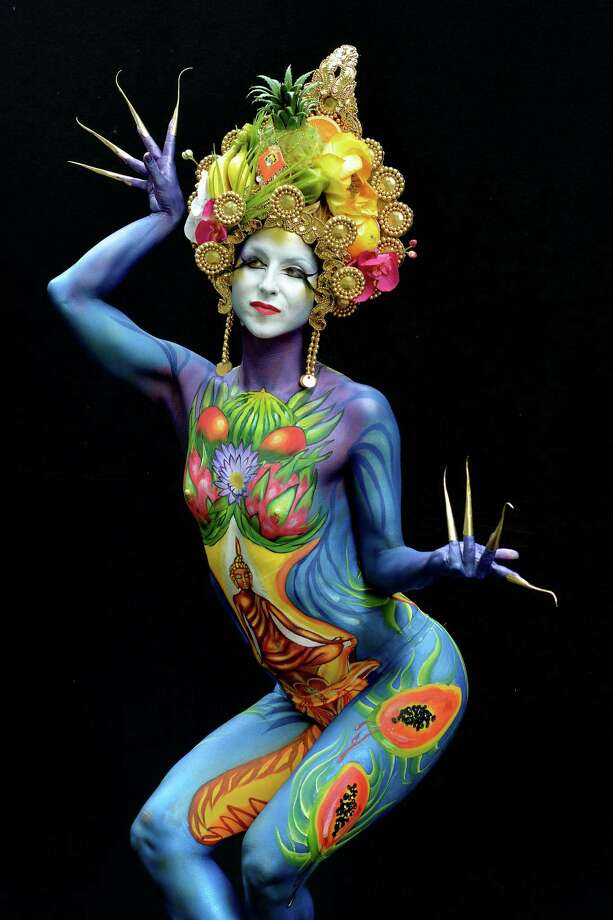A participant poses with her body paintings designed by bodypainting artist Lynn Schockmel  during the 16th World Bodypainting Festival on July 5, 2013 in Poertschach am Woerthersee, Austria. Photo: Didier Messens, Getty Images / 2013 Didier Messens