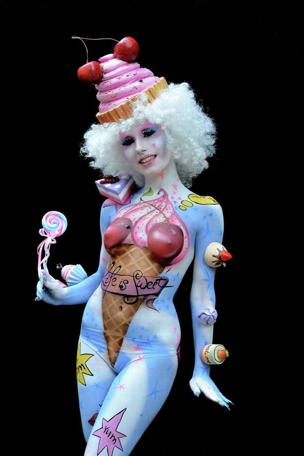 A participant poses with her body paintings designed by bodypainting artist Yuliya Ochkan during the 16th World Bodypainting Festival on July 5, 2013 in Poertschach am Woerthersee, Austria. Photo: Didier Messens, Getty Images / 2013 Didier Messens