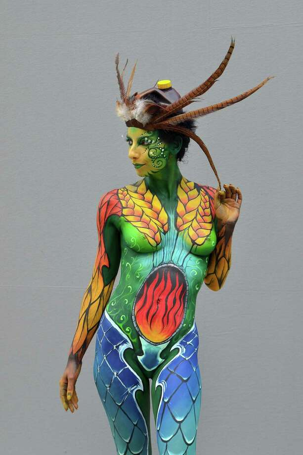 A participant poses with her body paintings designed by bodypainting artist Francois Rose during the 16th World Bodypainting Festival on July 5, 2013 in Poertschach am Woerthersee, Austria. Photo: Didier Messens, Getty Images / 2013 Didier Messens