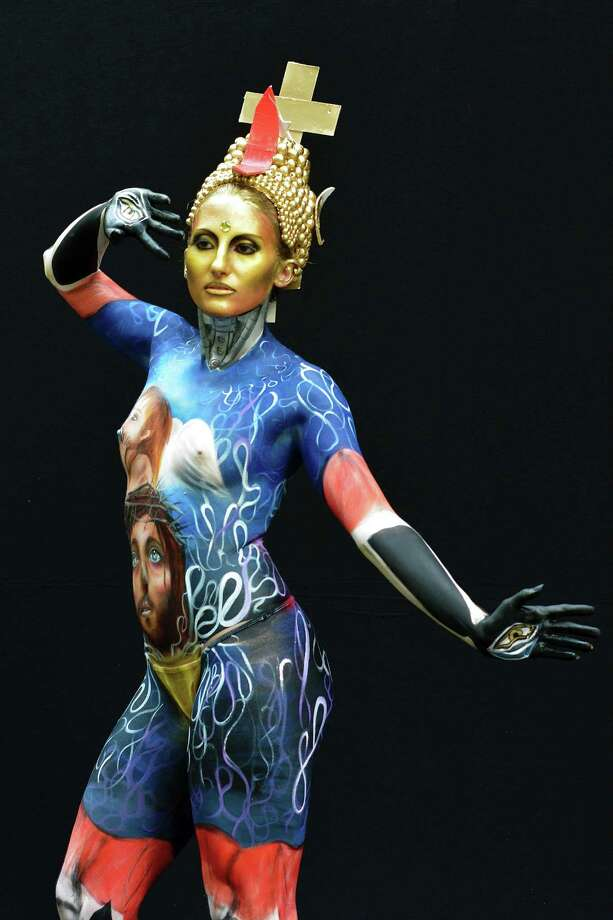 A participant poses with her body paintings designed by bodypainting artist Giusy Campolungo during the 16th World Bodypainting Festival on July 5, 2013 in Poertschach am Woerthersee, Austria. Photo: Didier Messens, Getty Images / 2013 Didier Messens