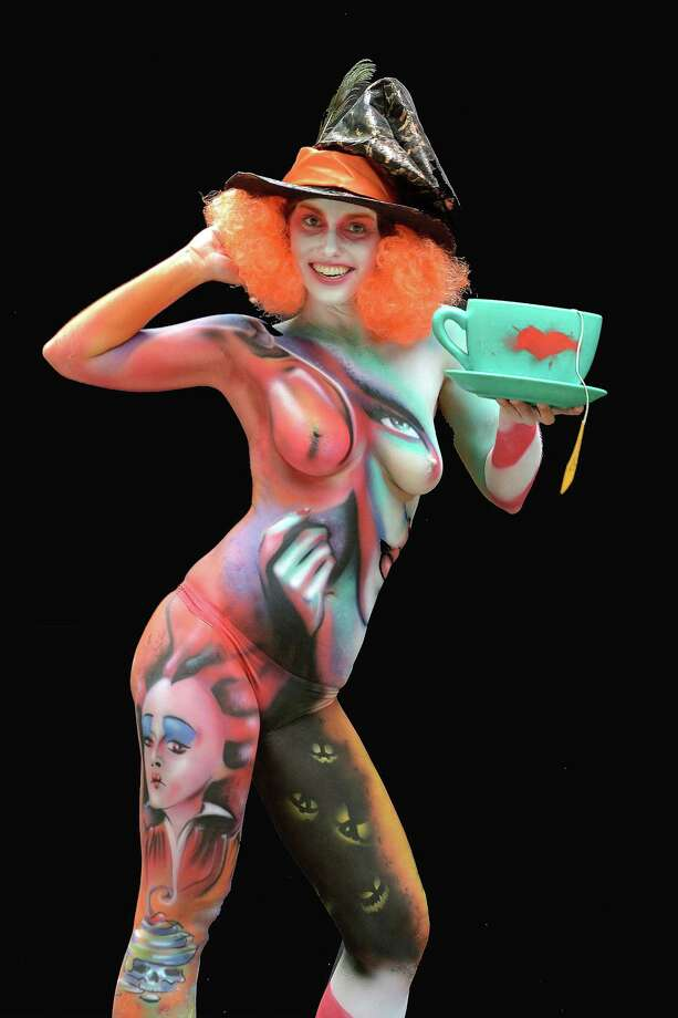 A participant poses with her body paintings designed by bodypainting artist Umberto Zanoni during the 16th World Bodypainting Festival in Poertschach on July 6, 2013 in Poertschach am Woerthersee, Austria. Photo: Didier Messens, Getty Images / 2013 Didier Messens