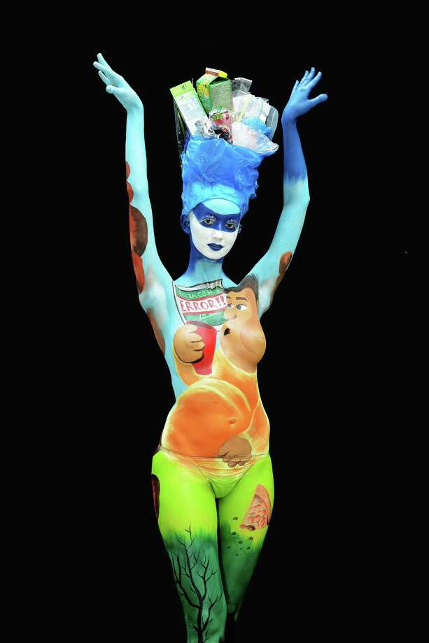 A participant poses with her body paintings designed by bodypainting artist Aneta Sebestianovaduring the 16th World Bodypainting Festival in Poertschach on July 6, 2013 in Poertschach am Woerthersee, Austria. Photo: Didier Messens, Getty Images / 2013 Didier Messens
