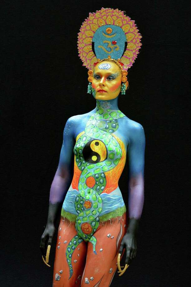 A participant poses with her body paintings designed by bodypainting artist Yasmina Jacinto during the 16th World Bodypainting Festival in Poertschach on July 6, 2013 in Poertschach am Woerthersee, Austria. Photo: Didier Messens, Getty Images / 2013 Didier Messens