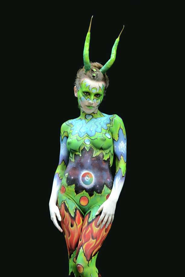 A participant poses with her body paintings designed by bodypainting artist Sandrine Lahou during the 16th World Bodypainting Festival in Poertschach on July 6, 2013 in Poertschach am Woerthersee, Austria. Photo: Didier Messens, Getty Images / 2013 Didier Messens