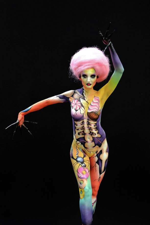 A participant poses with her body paintings designed by bodypainting artist Anne Caze during the 16th World Bodypainting Festival in Poertschach on July 6, 2013 in Poertschach am Woerthersee, Austria. Photo: Didier Messens, Getty Images / 2013 Didier Messens