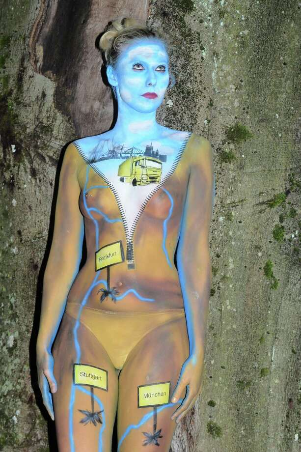 A participant poses with her body paintings designed by bodypainting artist Micha Joos during the 16th World Bodypainting Festival in Poertschach on July 6, 2013 in Poertschach am Woerthersee, Austria. Photo: Didier Messens, Getty Images / 2013 Didier Messens