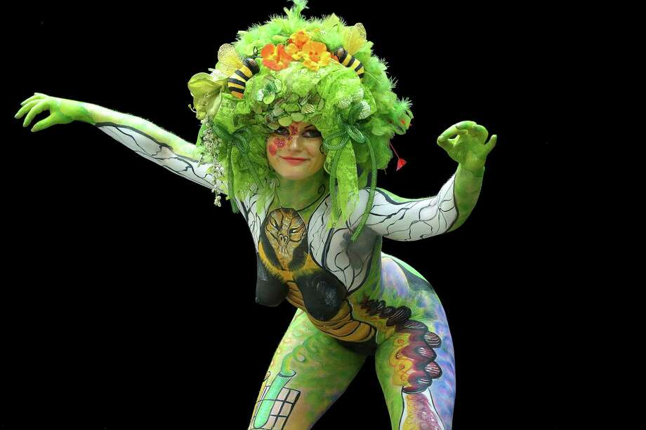 A participant poses with her body paintings designed by bodypainting artist Tanja Hommes during the 16th World Bodypainting Festival in Poertschach on July 6, 2013 in Poertschach am Woerthersee, Austria. Photo: Didier Messens, Getty Images / 2013 Didier Messens
