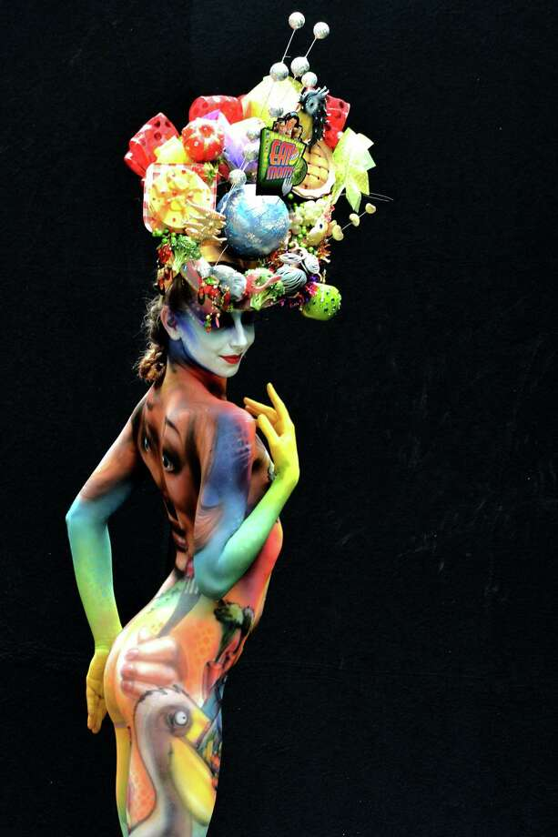 A participant poses with her body paintings designed by bodypainting artist Scott Fray during the 16th World Bodypainting Festival in Poertschach on July 6, 2013 in Poertschach am Woerthersee, Austria. Photo: Didier Messens, Getty Images / 2013 Didier Messens