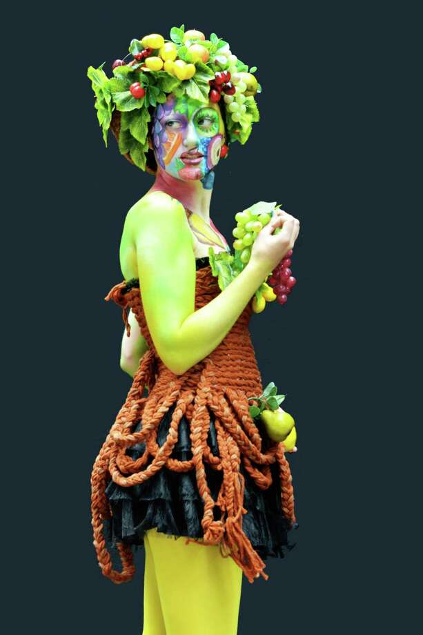 A participant poses with her body paintings designed by bodypainting artist Anastassiya Doronina during the 16th World Bodypainting Festival in Poertschach on July 6, 2013 in Poertschach am Woerthersee, Austria. Photo: Didier Messens, Getty Images / 2013 Didier Messens
