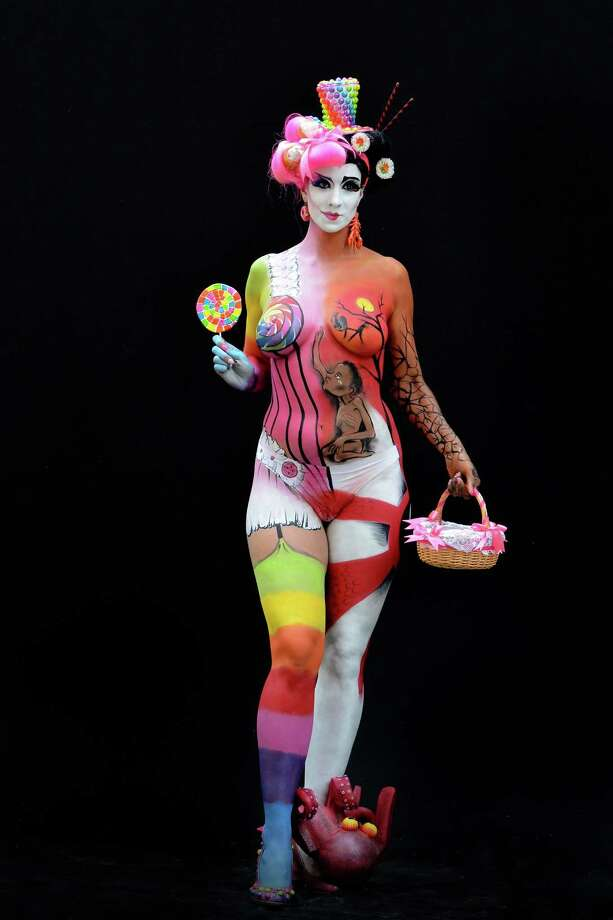 A participant poses with her body paintings designed by bodypainting artist Helena Jordana during the 16th World Bodypainting Festival in Poertschach on July 6, 2013 in Poertschach am Woerthersee, Austria. Photo: Didier Messens, Getty Images / 2013 Didier Messens