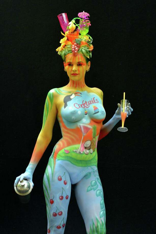 A participant poses with her body paintings designed by bodypainting artist Birgit Linke during the 16th World Bodypainting Festival in Poertschach on July 6, 2013 in Poertschach am Woerthersee, Austria. Photo: Didier Messens, Getty Images / 2013 Didier Messens