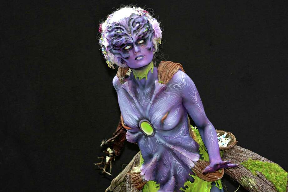 A participant poses with her body paintings designed by bodypainting artist Houyam Hajlaoui during the 16th World Bodypainting Festival in Poertschach. This artist won the world cup in the sfx bodypainting category on July 6, 2013 in Poertschach am Woerthersee, Austria. Photo: Didier Messens, Getty Images / 2013 Didier Messens