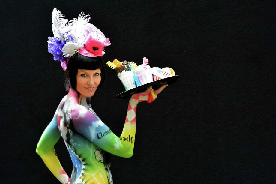 A participant poses with her body paintings designed by bodypainting artist Flavio Bosco during the 16th World Bodypainting Festival in Poertschach on July 6, 2013 in Poertschach am Woerthersee, Austria. Photo: Didier Messens, Getty Images / 2013 Didier Messens