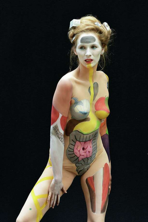 A participant poses with her body paintings designed by bodypainting artist Melissa Brunner during the 16th World Bodypainting Festival in Poertschach on July 6, 2013 in Poertschach am Woerthersee, Austria. Photo: Didier Messens, Getty Images / 2013 Didier Messens