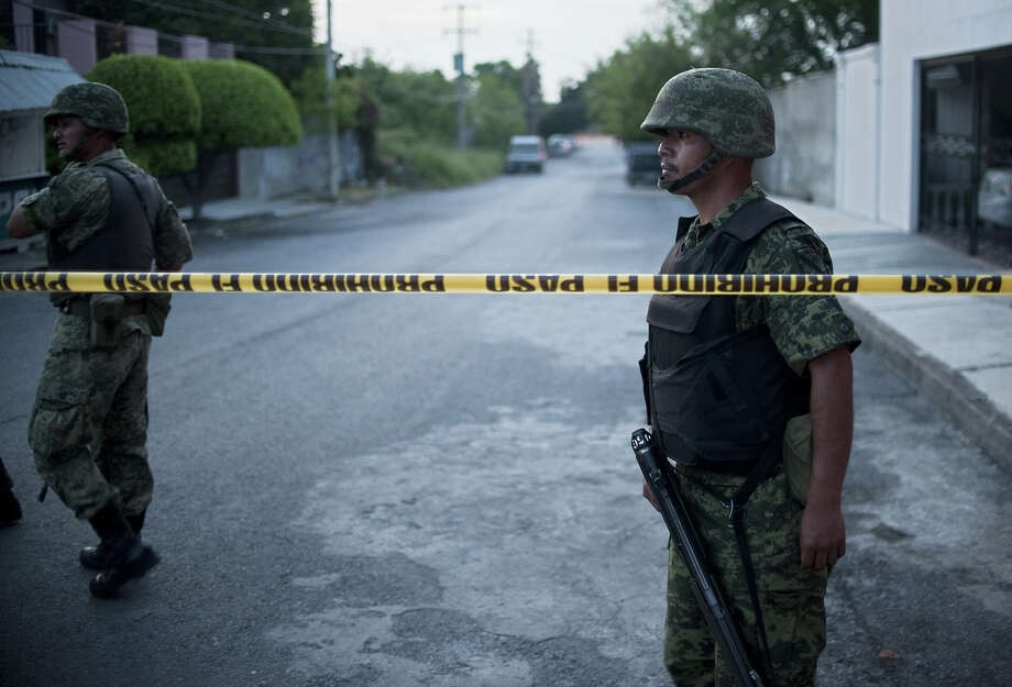 Mexican soldiers are displayed nearby Televisa TV network after a car bomb exploded with no casualties, early  Friday in the northeastern city Ciudad Victoria, Tamaulipas state on August 27, 2010. The Gulf of Mexico drug cartel has been engaged in a bitter turf war for control of Tamaulipas smuggling routes into the United States with the Zetas drug cartel. Photo: RONALDO SCHEMIDT, AFP/Getty Images / 2010 AFP