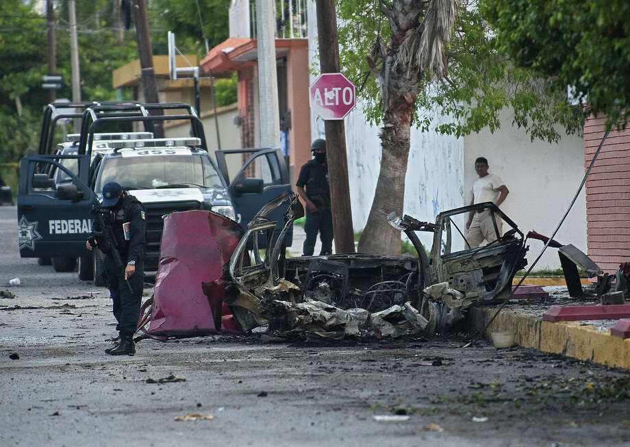 A burned car is pictured in front of Televisa TV network after a car bomb exploded with no casualties, early  Friday in the northeastern city Ciudad Victoria, Tamaulipas state on August 27, 2010. The Gulf of Mexico drug cartel has been engaged in a bitter turf war for control of Tamaulipas smuggling routes into the United States with the Zetas drug cartel. Photo: RONALDO SCHEMIDT, AFP/Getty Images / 2010 AFP