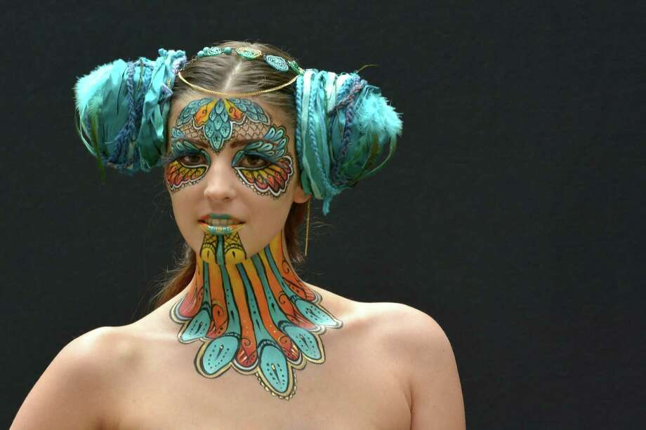 A participant poses with her body paintings designed by bodypainting artist Kyla Morgan during the 16th World Bodypainting Festival in Poertschach. on July 6, 2013 in Poertschach am Woerthersee, Austria. Photo: Didier Messens, Getty Images / 2013 Didier Messens