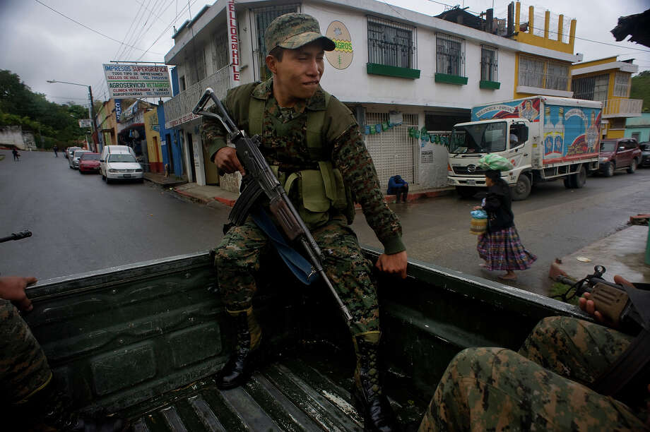 "Soldiers patrol the town of Coban, Guatemala, on Thursday, January 27, 2011. Guatemalan President Alvaro Colom has extended a U.S.-backed ""state of siege"" in the Alta Verapaz province, where authorities say they are fighting an invasion by the ruthless Mexican cartel known as the Zetas. Photo: The Washington Post, Washington Post/Getty Images / 2011 The Washington Post"