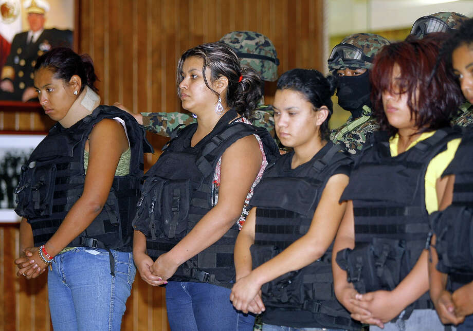 A group of women of Los Zetas drug cartel are presented to the press at the Mexican Navy headquarters in Mexico City on April 17, 2011. The women were arrested with Omar Estrada Luna last Saturday. Estrada is accused of having planned and ordered the killing of 72 migrants on August 2010 and having ordered the slaughter of more than 145 people, found in mass graves in San Fernando. The battles between drug lords have claimed more than 35,000 dead across the country over the past three years, according to official figures. Photo: STR, AFP/Getty Images / 2011 AFP