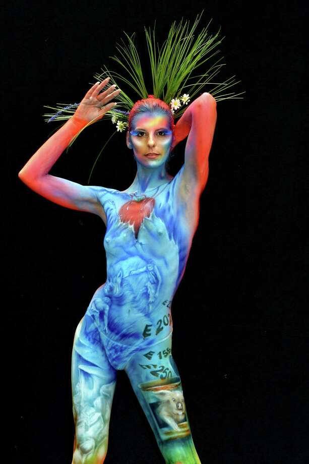 A participant poses with her body paintings designed by bodypainting artist Melanie Hill during the 16th World Bodypainting Festival in Poertschach on July 6, 2013 in Poertschach am Woerthersee, Austria. Photo: Didier Messens, Getty Images / 2013 Didier Messens