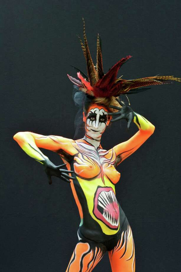 A participant poses with her body paintings designed by bodypainting artist Heli Tikkanen during the 16th World Bodypainting Festival on July 6, 2013 in Poertschach am Woerthersee, Austria. Photo: Didier Messens, Getty Images / 2013 Didier Messens