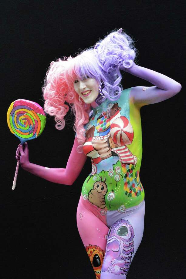 A participant poses with her body paintings designed by bodypainting artist Constanze Ryniak during the 16th World Bodypainting Festival in Poertschach on July 6, 2013 in Poertschach am Woerthersee, Austria. Photo: Didier Messens, Getty Images / 2013 Didier Messens