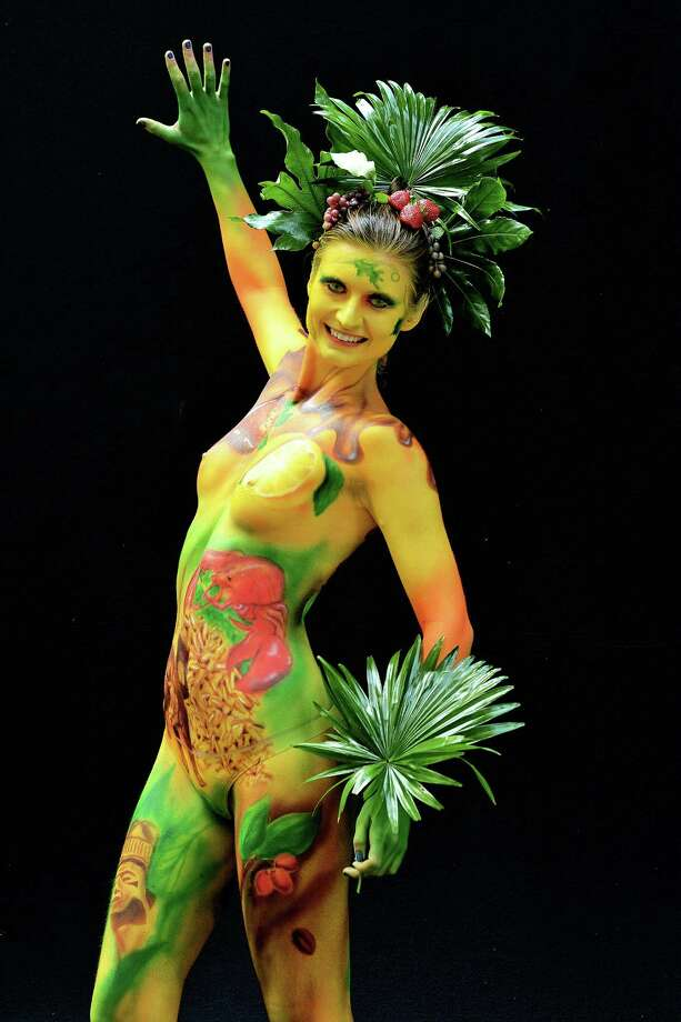 A participant poses with her body paintings designed by bodypainting artist Bruno Leyser during the 16th World Bodypainting Festival in Poertschach on July 6, 2013 in Poertschach am Woerthersee, Austria. Photo: Didier Messens, Getty Images / 2013 Didier Messens
