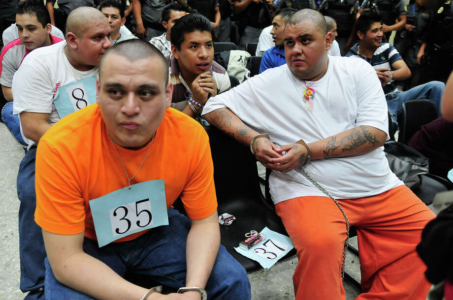 Suspected members of the Mexican drug cartel 'Los Zetas' from Guatemala and Mexico wait in court for a judgement in Guatemala City on June 27, 2012. Over 30 people accused of belonging to the drug cartel Zetas were to be sentenced on various offenses, including murder, kidnapping and other crimes. Photo: AFP, AFP/Getty Images / 2012 AFP
