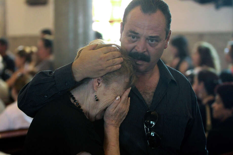 Relatives of a victim of the Casino Royale mourn as they attend a mass for the commemoration of the first anniversary of the crime in Monterrey, Mexico, on August 25, 2012. 52 people died on August 25, 2011, when members of Los Zetas drug cartel doused the Casino Royale with gasoline and set it ablaze. More than 40.000 people have been killed in rising drug-related violence in Mexico since December 2006, when President Felipe Calderon deployed soldiers and federal police to take on organized crime. Photo: AFP, AFP/Getty Images / 2012 AFP