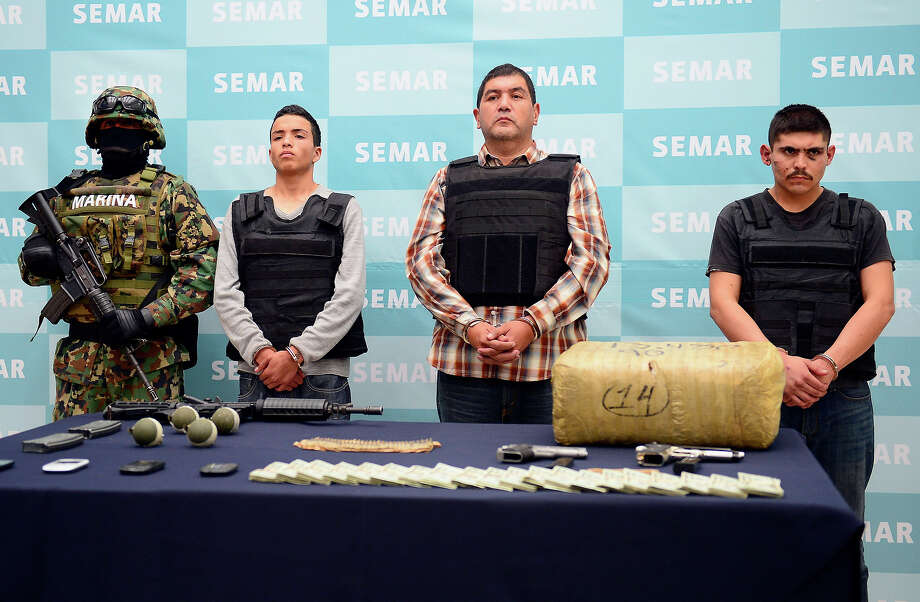 "Ivan Velazquez Caballero, aka ""Z 50"" or ""El Taliban"" (2nd-R),  senior leader in the Zetas drug cartel and member of the Gulf cartel, is presented to the press at the Mexican Navy headquarters in Mexico City, on September 27, 2012.  Velazquez Caballero was on a list of Mexico's most wanted drug traffickers, with an offer of some $2.3 million for information leading to his capture. Photo: ALFREDO ESTRELLA, AFP/Getty Images / 2012 AFP"