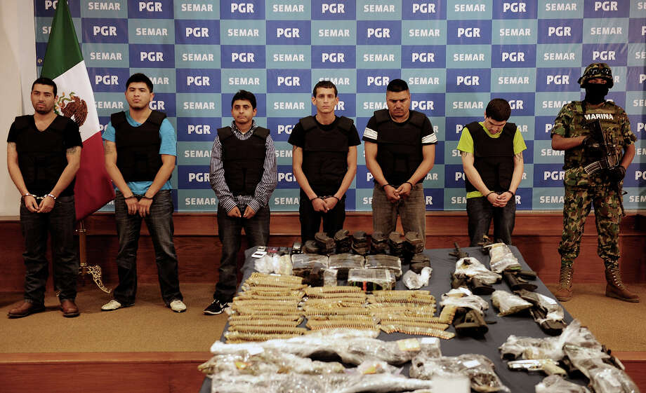 "Salvador Alfonso Martinez, aka ""Ardilla"", (3rd-L), alleged member of the Los Zetas Cartel and alleged mastermind of the San Fernando slaughter, is presented with accomplices to the media at the General Attorney's offices in Mexico City, on October 8, 2012.  Some 50,000 people have been killed in mostly drug-related violence in Mexico since 2006, when the government launched a massive military crackdown on the powerful cartels, which also battle each other over territory. Photo: ALFREDO ESTRELLA, AFP/Getty Images / 2012 AFP"