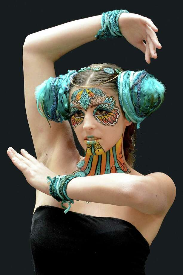 A participant poses with her body paintings designed by bodypainting artist Kyla Morgan during the 16th World Bodypainting Festival in Poertschach on July 6, 2013 in Poertschach am Woerthersee, Austria. Photo: Didier Messens, Getty Images / 2013 Didier Messens