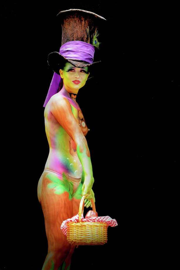 A participant poses with her body paintings designed by bodypainting artist Francesca Tariciotti during the 16th World Bodypainting Festival in Poertschach on July 6, 2013 in Poertschach am Woerthersee, Austria. Photo: Didier Messens, Getty Images / 2013 Didier Messens