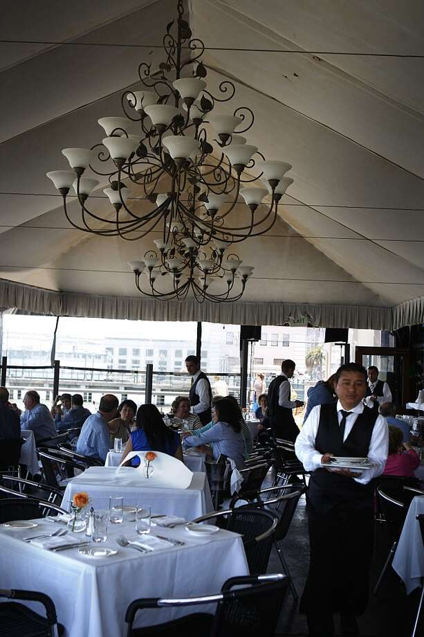 A view of the tented dining area .