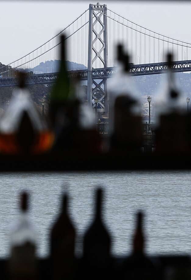 A view of the bay bridge through the window of the bar area.