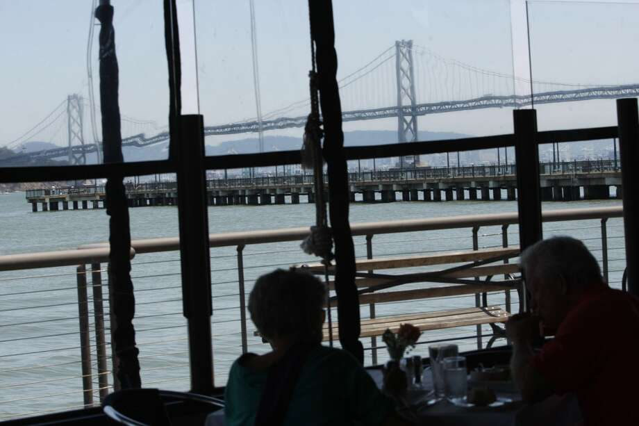 A view of the bay bridge from the outside dining area.