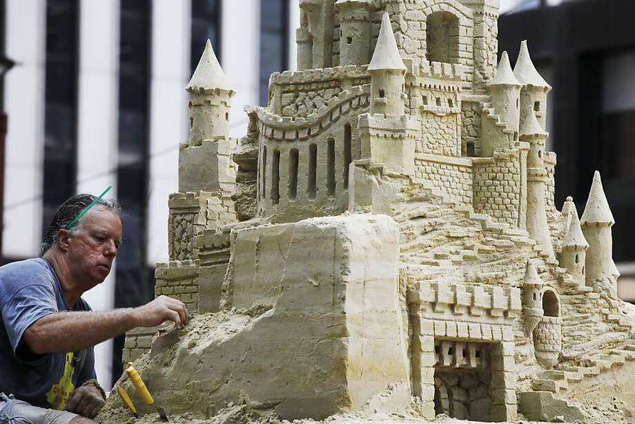 Fortress of silica:Sculptor Matt Long carves a sand castle in lower Manhattan. The 18-foot-high sculpture will take about three weeks to complete. Photo: Mark Lennihan, Associated Press