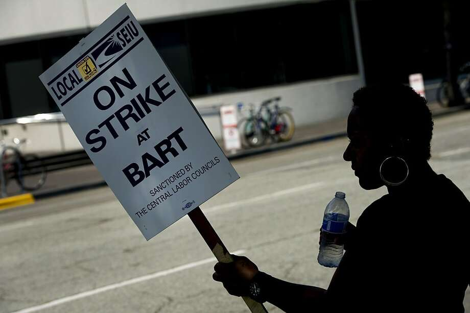 BART employee Claudia Horton joins other union members picketing in front of the Lake Merritt BART station during the BART strike in Oakland in July. Photo: David Paul Morris, Bloomberg