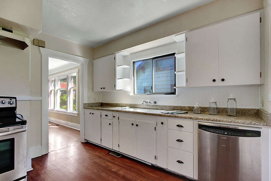 Kitchen of 531 28th Ave. The 2,140-square-foot house, built in 1926, has three bedrooms, one bathroom, a den/office, and a front porch on a 4,550-square-foot lot. It's listed for $449,950. Photo: Jenny Jenkins, Vicaso Photography, Courtesy Albert Clark, NWG Real Estate