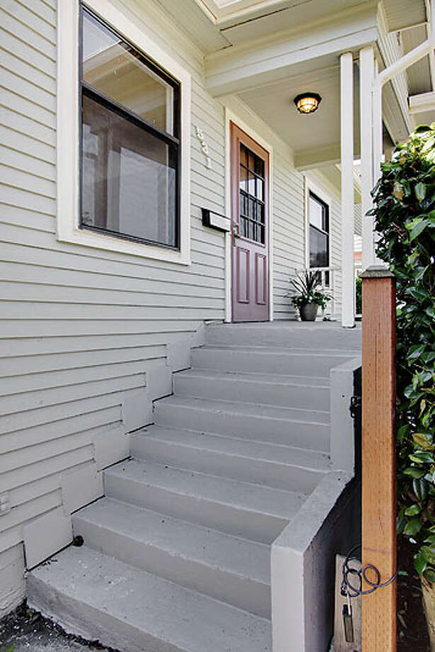 Front porch of 531 28th Ave. The 2,140-square-foot house, built in 1926, has three bedrooms, one bathroom and a den/office on a 4,550-square-foot lot. It's listed for $449,950. Photo: Jenny Jenkins, Vicaso Photography, Courtesy Albert Clark, NWG Real Estate