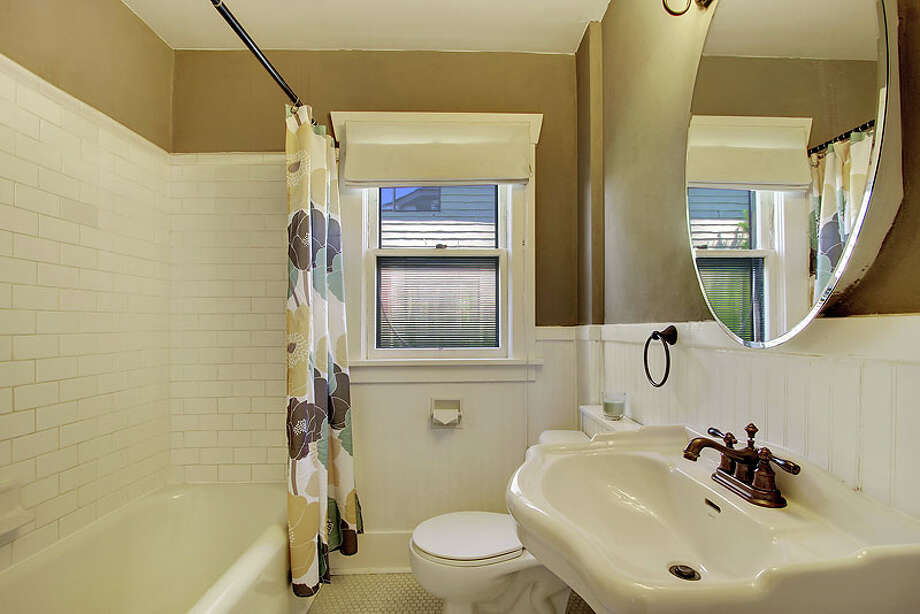 Bathroom of 531 28th Ave. The 2,140-square-foot house, built in 1926, has three bedrooms, one bathroom, a den/office, and a front porch on a 4,550-square-foot lot. It's listed for $449,950. Photo: Jenny Jenkins, Vicaso Photography, Courtesy Albert Clark, NWG Real Estate