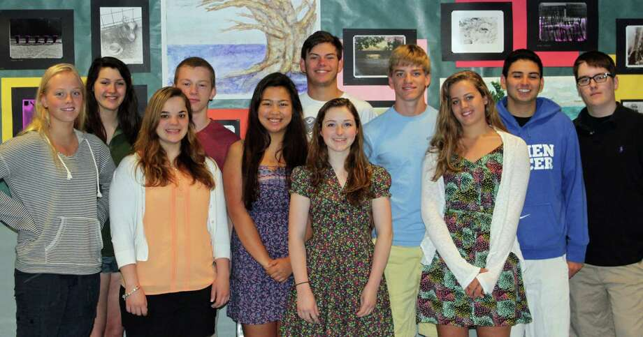 Among the Darien Community Association scholarship recipients are, from left, Olivia Leunis, Lauren Sestito, Anne Marie Manjuck, Greg Marku, Emily Caccam, Matt Brown, Kelly Manhart, Harrison Perley, Althea Perley, Jose Herrera and Tyler Stratton. Photo: Contributed