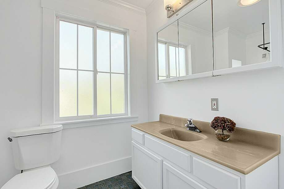 Master bathroom of 2024 E. Spruce St. The 2,440-square-foot Victorian, built in 1900, has three bedrooms, 2.5 bathrooms, a front stoop and a large back deck on a 2,640-square-foot lot. It's listed for $469,900. Photo: Courtesy Chad Dierickx, Redfin