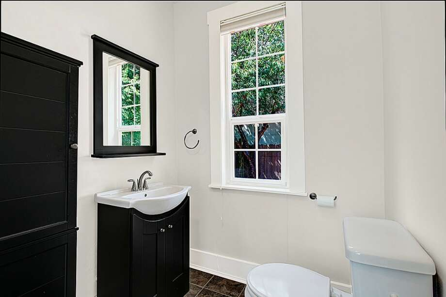 Powder room of 2024 E. Spruce St. The 2,440-square-foot Victorian, built in 1900, has three bedrooms, 2.5 bathrooms, a front stoop and a large back deck on a 2,640-square-foot lot. It's listed for $469,900. Photo: Courtesy Chad Dierickx, Redfin