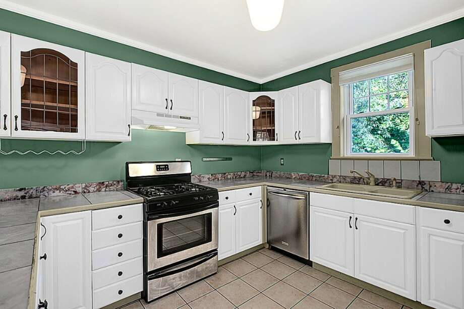 Kitchen of 2024 E. Spruce St. The 2,440-square-foot Victorian, built in 1900, has three bedrooms, 2.5 bathrooms, a front stoop and a large back deck on a 2,640-square-foot lot. It's listed for $469,900. Photo: Courtesy Chad Dierickx, Redfin