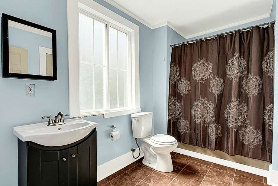 Bathroom of 2024 E. Spruce St. The 2,440-square-foot Victorian, built in 1900, has three bedrooms, 2.5 bathrooms, a front stoop and a large back deck on a 2,640-square-foot lot. It's listed for $469,900. Photo: Courtesy Chad Dierickx, Redfin